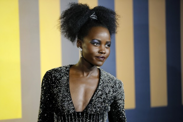 Kenyan-Mexican actress Lupita Nyong'o poses on arrival for the European Premiere of 'Black Panther' in central London on February 8, 2018. / AFP PHOTO / Tolga AKMEN (Photo credit should read TOLGA AKMEN/AFP/Getty Images)