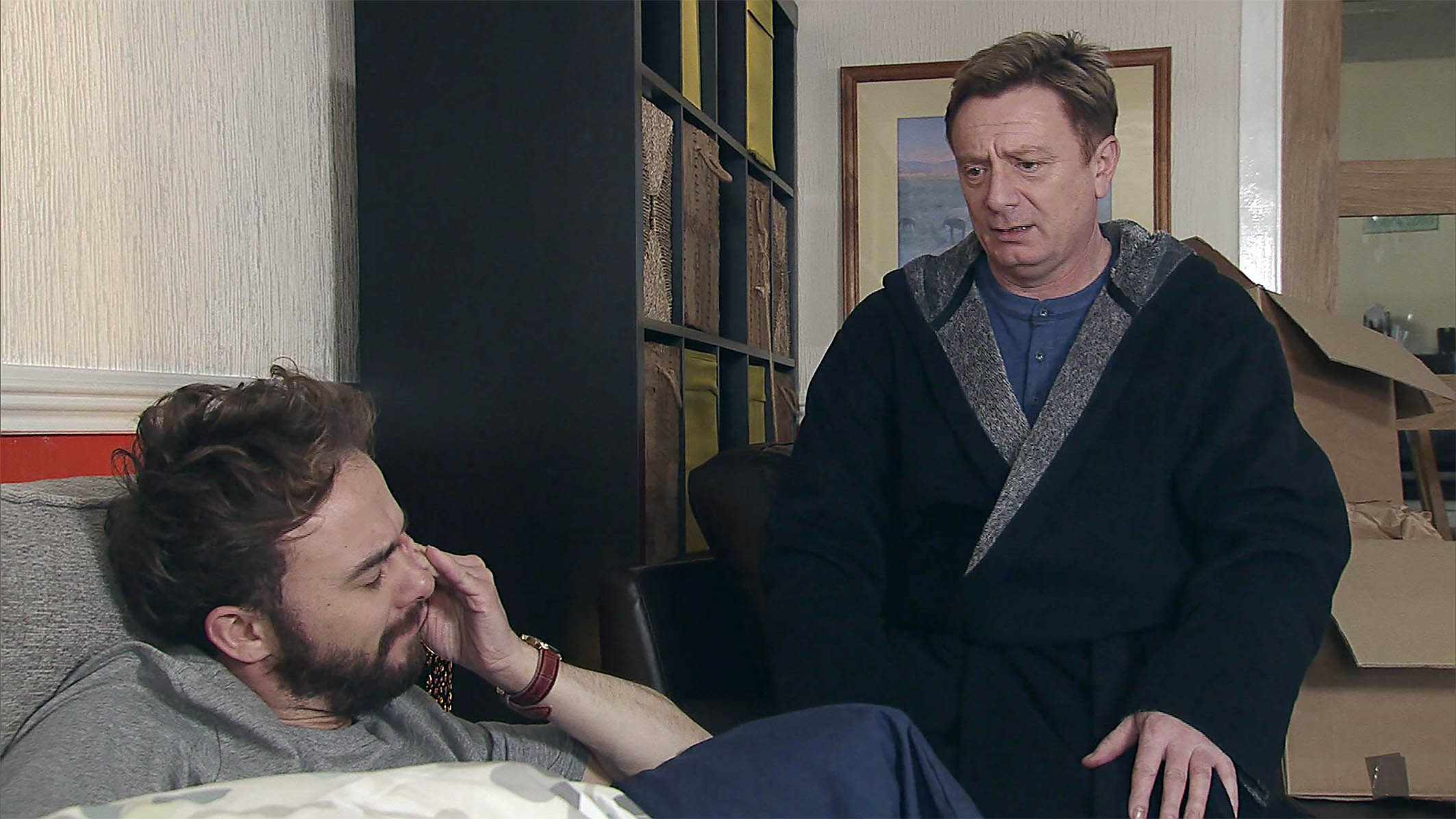 FROM ITV   STRICT EMBARGO - No Use Before Tuesday 13 March 2018  Coronation Street - Ep 9411  Thursday 22nd March 2018   Waking up on Martin Platt's [SEAN WILSON] sofa from a fitful night's sleep David Platt [JACK P SHEPHERD] is interested as Martin talks about his plans to move to New Zealand.   Picture contact - david.crook@itv.com  This photograph is (C) ITV Plc and can only be reproduced for editorial purposes directly in connection with the programme or event mentioned above, or ITV plc. Once made available by ITV plc Picture Desk, this photograph can be reproduced once only up until the transmission [TX] date and no reproduction fee will be charged. Any subsequent usage may incur a fee. This photograph must not be manipulated [excluding basic cropping] in a manner which alters the visual appearance of the person photographed deemed detrimental or inappropriate by ITV plc Picture Desk. This photograph must not be syndicated to any other company, publication or website, or permanently archived, without the express written permission of ITV Plc Picture Desk. Full Terms and conditions are available on the website www.itvpictures.com