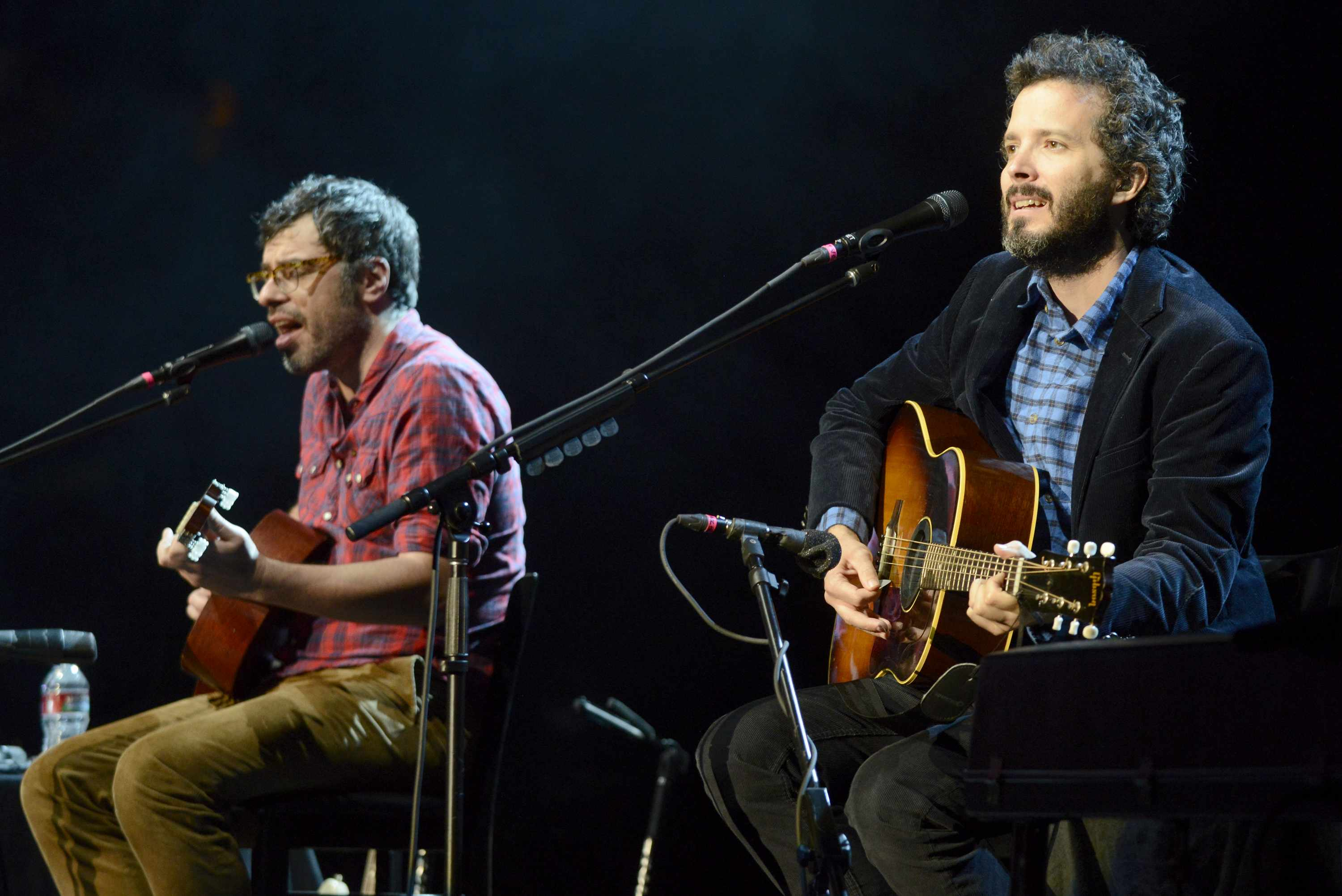 MOUNTAIN VIEW, CA - SEPTEMBER 20: Jemaine Clement (L) and Bret McKenzie of Flight of the Conchords perform as part of the The Oddball Comedy & Curiosity Festival at Shoreline Amphitheatre on September 20, 2013 in Mountain View, California. (Photo by Tim Mosenfelder/Getty Images)  Getty, TL