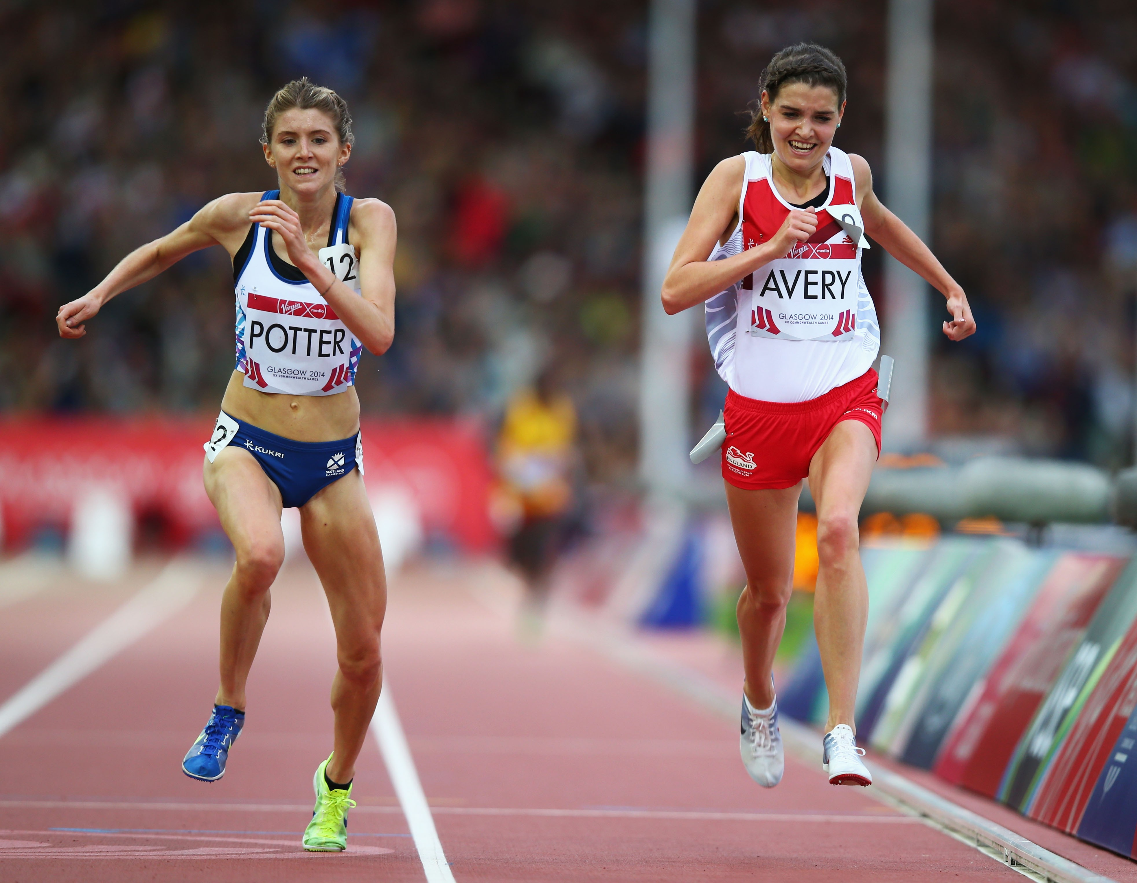 GLASGOW, SCOTLAND - JULY 29:  (L-R) Beth Potter of Scotland and Kate Avery of England sprint to the finish line in the Women's 10,000 metres final at Hampden Park during day six of the Glasgow 2014 Commonwealth Games on July 29, 2014 in Glasgow, United Kingdom.  (Photo by Clive Rose/Getty Images)