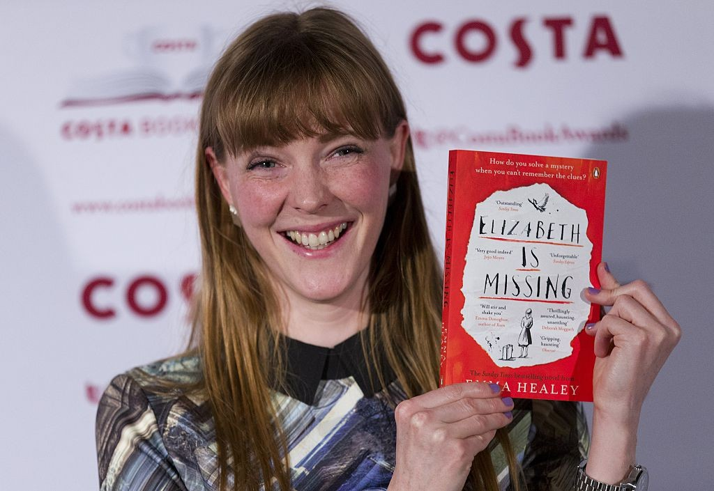 British author Emma Healey poses with her First Novel Award winning book 'Elizabeth is Missing' as she arrives for the 2014 Costa Book Awards in London on January 27, 2015. The Costa Book Awards is a literary prize that recognises some of the most enjoyable books of the year by writers based in the UK and Ireland in five categories, with one of the category winners selected as Costa Book of the Year.  AFP PHOTO / JUSTIN TALLIS        (Photo credit should read JUSTIN TALLIS/AFP/Getty Images)