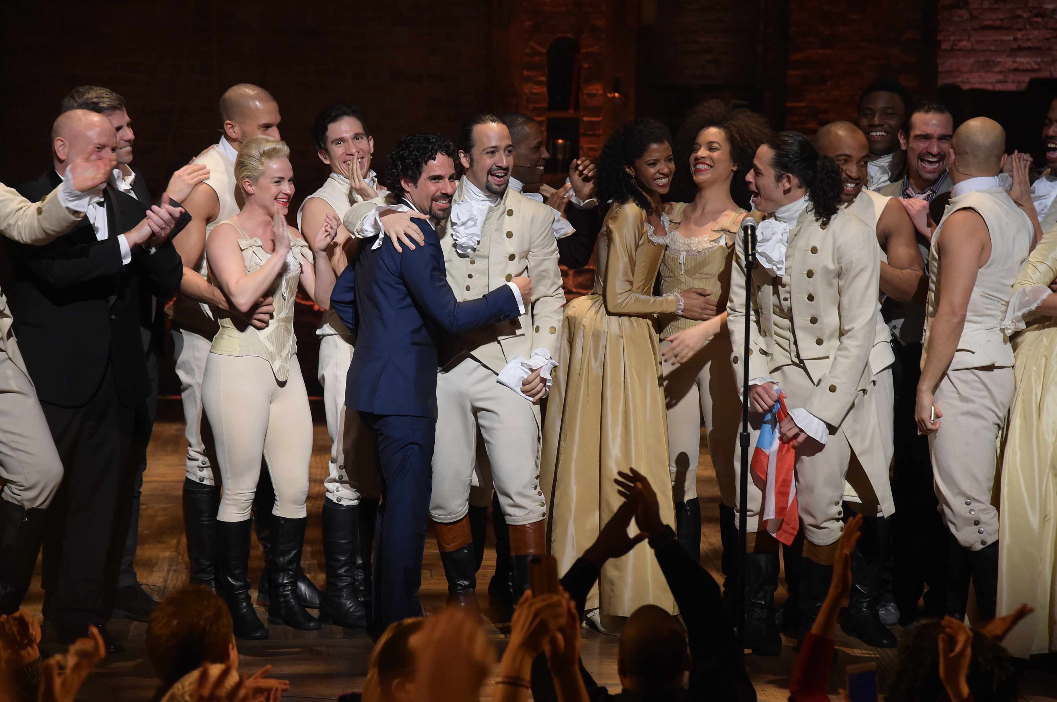 """NEW YORK, NY - FEBRUARY 15:  Music director Alex Lacamoire and actor, composer Lin-Manuel Miranda and cast of """"Hamilton"""" celebrate on stage the receiving of GRAMMY award after """"Hamilton"""" GRAMMY performance for The 58th GRAMMY Awards at Richard Rodgers Theater on February 15, 2016 in New York City.  (Photo by Theo Wargo/Getty Images)  Getty, TL"""