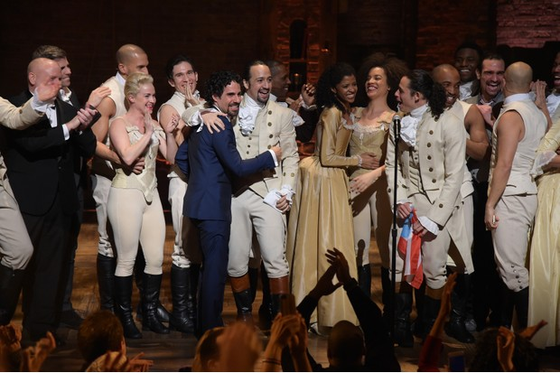 """Music director Alex Lacamoire and actor, composer Lin-Manuel Miranda and cast of """"Hamilton"""" celebrate on stage the receiving of GRAMMY award after """"Hamilton"""" GRAMMY performance for The 58th GRAMMY Awards at Richard Rodgers Theater on February 15, 2016 in New York City.  (Photo Getty Images)"""