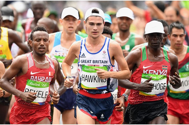 RIO DE JANEIRO, BRAZIL - AUGUST 21: Eliud Kipchoge of Kenya, Callum Hawkins of Great Britain and Alemu Bekele of Bahrain compete during the Men's Marathon on Day 16 of the Rio 2016 Olympic Games at Sambodromo on August 21, 2016 in Rio de Janeiro, Brazil. (Photo by Quinn Rooney/Getty Images)