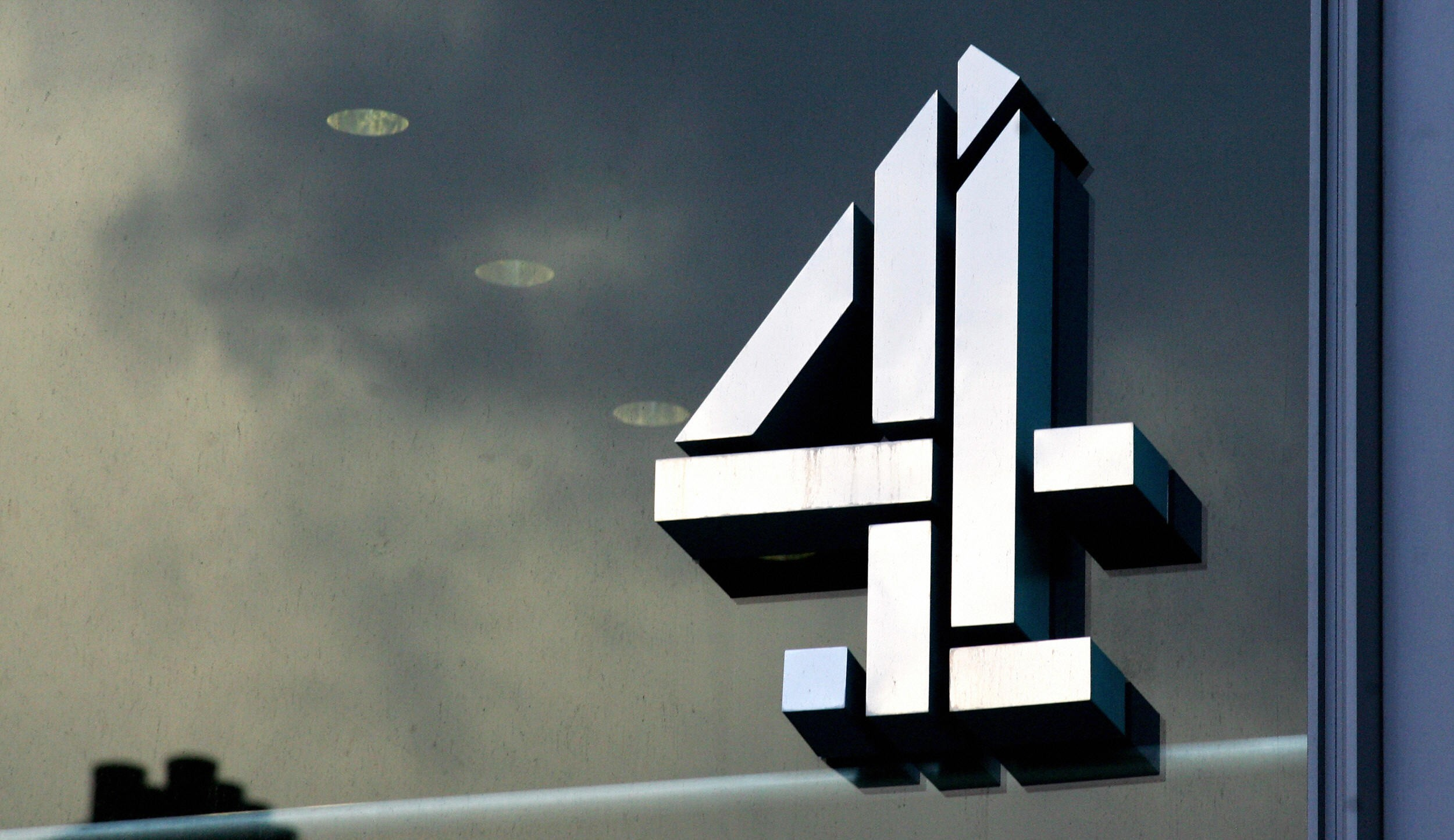 "London, UNITED KINGDOM:  The logo of Britain's Channel 4 television station is pictured at the company's headquarters in central London, 18 January 2007. Carphone Warehouse, the main backer of Channel 4's reality television show 'Celebrity Big Brother,' pulled its support Thursday as complaints about alleged racist bullying spiralled and criticism mounted. Mobile communications retailer the Carphone Warehouse said it had told broadcaster Channel 4 to remove its name and branding from the programme with immediate effect, saying it did not want to be associated with it.  But Channel 4 chief executive Andy Duncan said Thursday they ""could not say with certainty"" that the comments directed at 31-year-old Bollywood actress Shilpa Shetty were racist or whether they stemmed from ""broader cultural or social differences"". And he rejected calls for the show to be pulled off air. AFP PHOTO/CARL DE SOUZA  (Photo credit should read CARL DE SOUZA/AFP/Getty Images)  Getty, TL"