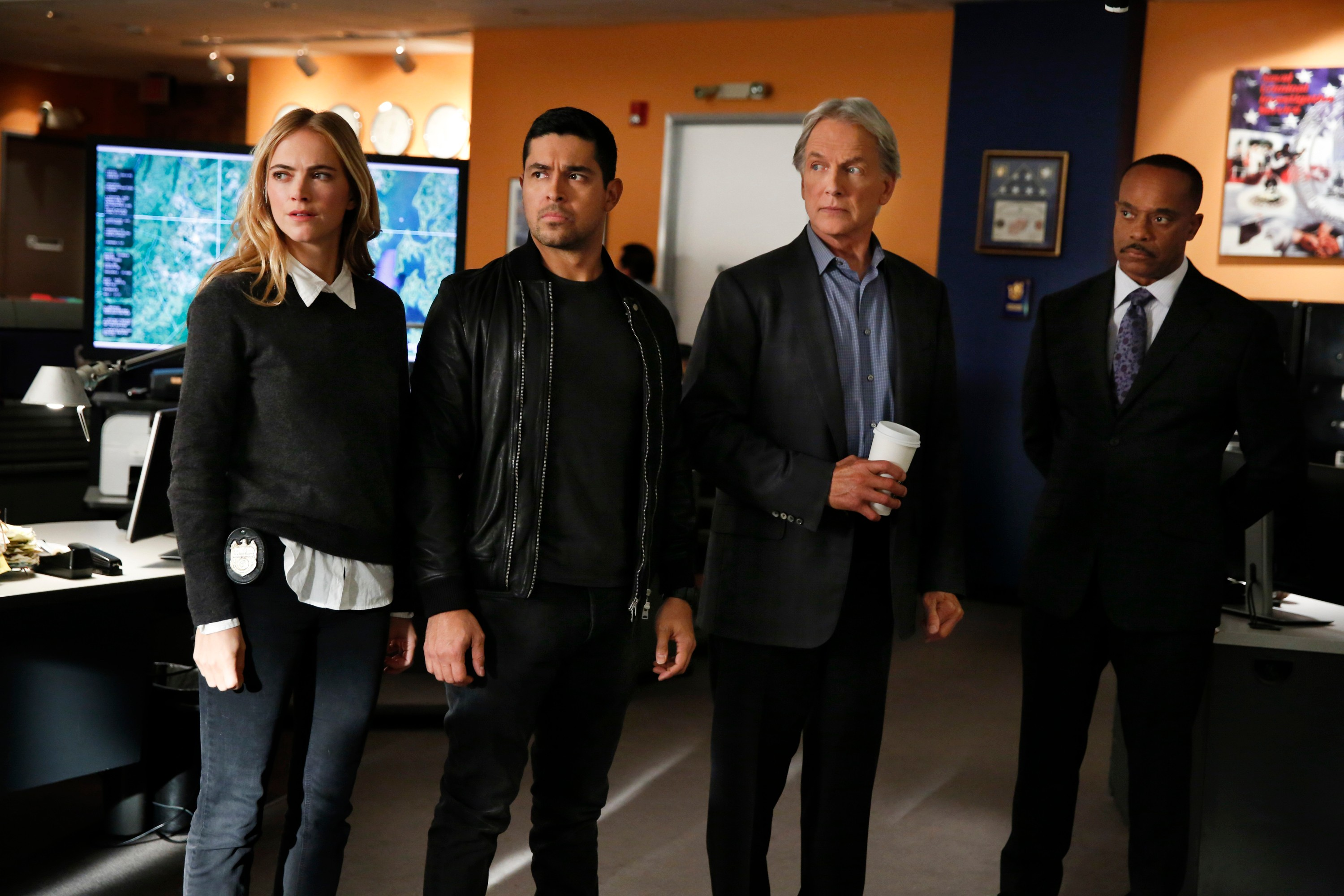 """LOS ANGELES - OCTOBER 12: """"Voices"""" -- An NCIS person of interest in a bribery and fraud case is found murdered after a runner is led to his body by a strange voice. Also, McGee and Delilah disagree on whether to find out the baby's sex or keep it a surprise, on NCIS, Tuesday, Nov. 14 (8:00-9:00 PM, ET/PT) on the CBS Television Network. Pictured: Emily Wickersham, Wilmer Valderramma, Mark Harmon, Rocky Carroll. (Photo by Cliff Lipson/CBS via Getty Images)  Getty, TL"""