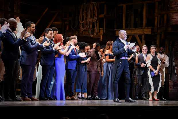 """LONDON, ENGLAND - DECEMBER 21:  The company of Hamilton during the curtain call of the press night performance of """"Hamilton"""" at The Victoria Palace Theatre on December 21, 2017 in London, England.  (Photo by David M. Benett/Dave Benett/Getty Images)"""