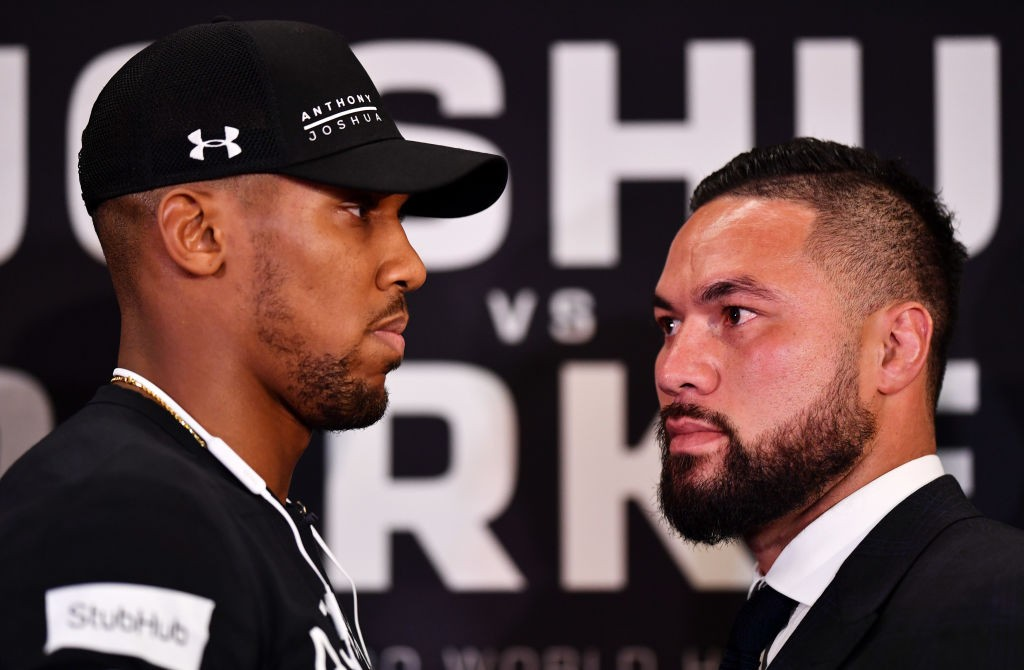 LONDON, ENGLAND - JANUARY 16:   Anthony Joshua and Joseph Parker square up during an Anthony Joshua and Joseph Parker Press Conference at the Dorchester Hotel on January 16, 2018 in London, England. (Photo by Justin Setterfield/Getty Images)