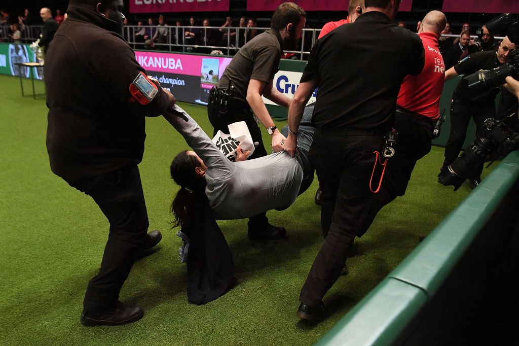 BIRMINGHAM, ENGLAND - MARCH 11:  A protestor is carried off after running into the area as Best In Show was being announced on day four of the Cruft's dog show at the NEC Arena on March 11, 2018 in Birmingham, England.  (Photo by Leon Neal/Getty Images)