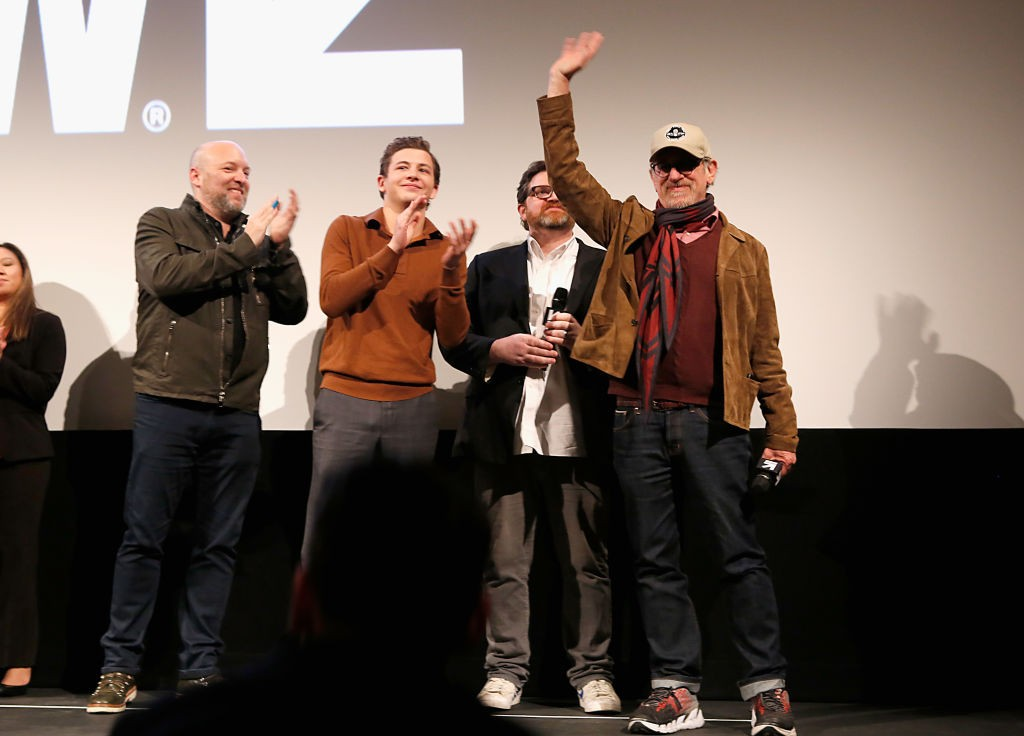 """AUSTIN, TX - MARCH 11:  Zak Penn, Tye Sheridan, Ernest Cline and  Steven Spielberg speak onstage at the premiere of """"Ready Player One"""" during SXSW at Paramount Theatre on March 11, 2018 in Austin, Texas.  (Photo by Sean Mathis/Getty Images for SXSW)"""