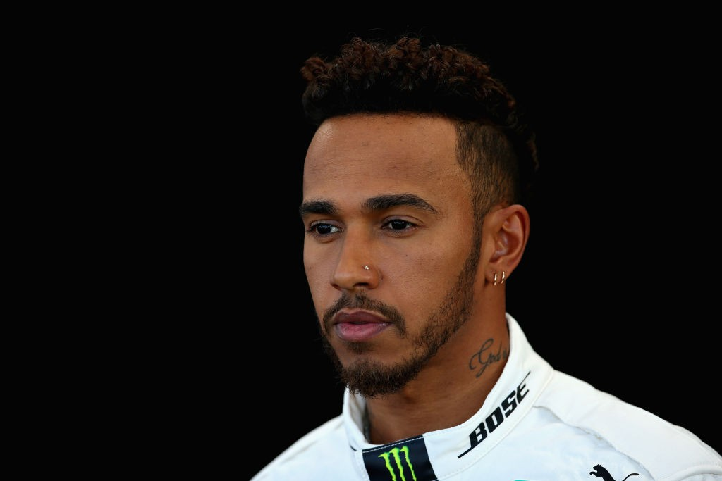 MELBOURNE, AUSTRALIA - MARCH 22: Lewis Hamilton of Great Britain and Mercedes GP poses for a photo during previews ahead of the Australian Formula One Grand Prix at Albert Park on March 22, 2018 in Melbourne, Australia.  (Photo by Charles Coates/Getty Images)