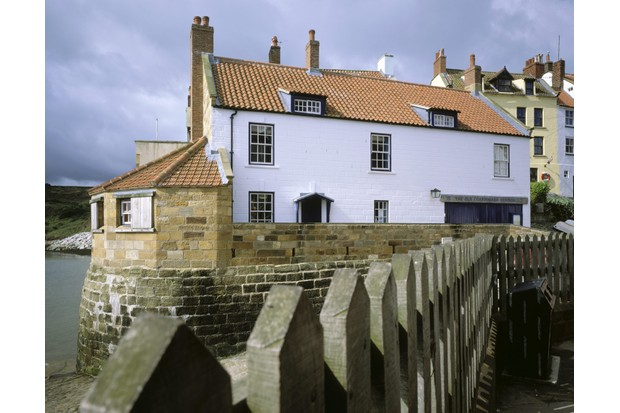 The Old Coastguard Station (N.T.) at Robin Hood's Bay, which is on part of the Cleveland Way long-distance footpath on this Heritage Coast in the North Yorkshire Moors National Park.
