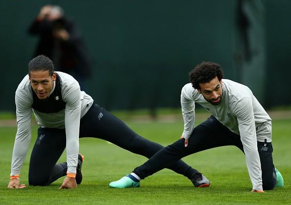 LIVERPOOL, ENGLAND - APRIL 23:  Virgil van Dijk and Mohamed Salah of Liverpool warm up during a training session on April 23, 2018 in Liverpool, England.  (Photo by Jan Kruger/Getty Images)