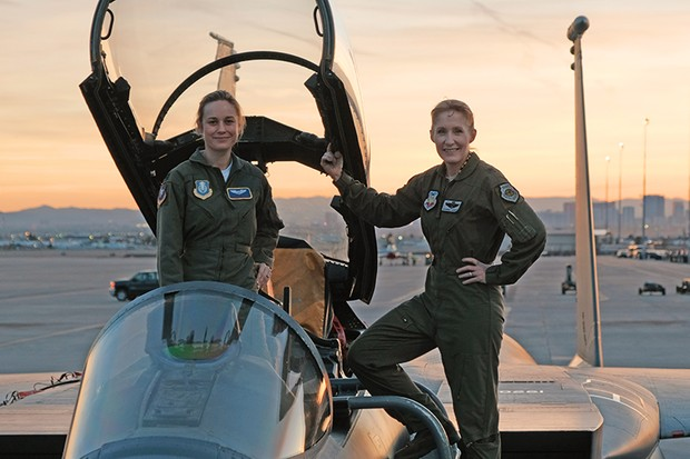 Marvel Studios' CAPTAIN MARVEL..Brie Larson (left) gets hands-on help from Brigadier General Jeannie Leavitt, 57th Wing Commander (right), on a recent trip to Nellis Air Force Base in Nevada to research her character, Carol Danvers aka Captain Marvel, for Marvel Studios (Marvel, HF)