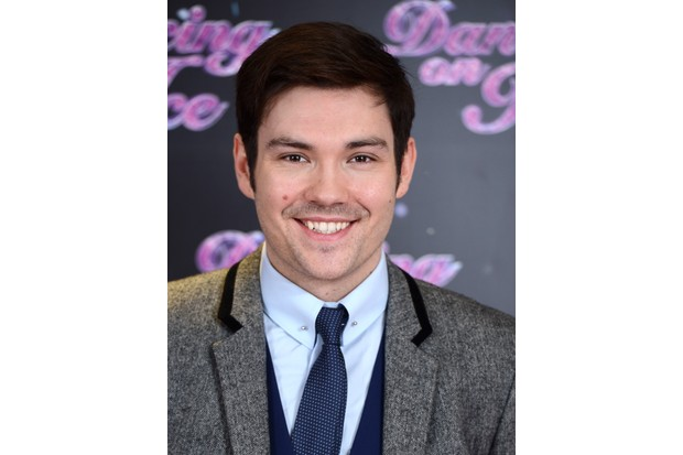 "LONDON, ENGLAND - JANUARY 02: Sam Attwater attends the series launch photocall for ""Dancing on Ice"" held at the London Studios on January 2, 2014 in London, England. (Photo by Karwai Tang/Getty Images)"