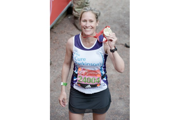 LONDON, ENGLAND - APRIL 24: Sophie Raworth poses with her medal after completing the Virgin Money London Marathon on April 24, 2016 in London, England. (Photo by Jeff Spicer/Getty Images)