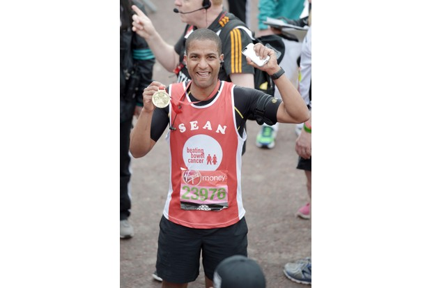 LONDON, ENGLAND - APRIL 24: Sean Fletcher poses with his medal after completing the Virgin Money London Marathon on April 24, 2016 in London, England. (Photo by Jeff Spicer/Getty Images)