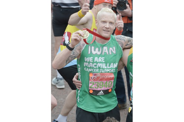 LONDON, ENGLAND - APRIL 24: Iwan Thomas poses with his medal after completing the Virgin Money London Marathon on April 24, 2016 in London, England. (Photo by Jeff Spicer/Getty Images)