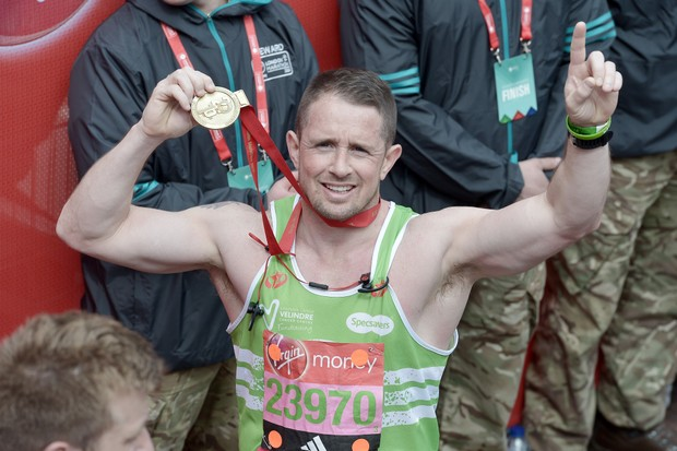 LONDON, ENGLAND - APRIL 24: Shane Williams poses with her medal after completing the Virgin Money London Marathon on April 24, 2016 in London, England. (Photo by Jeff Spicer/Getty Images)