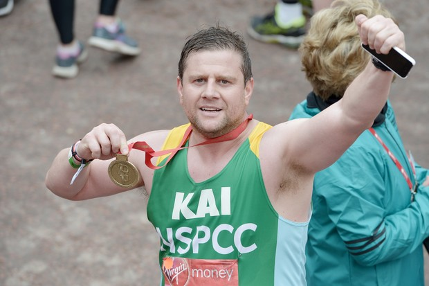 LONDON, ENGLAND - APRIL 24: Kai Owen poses with his medal after completing the Virgin Money London Marathon on April 24, 2016 in London, England. (Photo by Jeff Spicer/Getty Images)