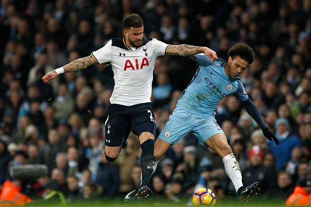 21st January 2017, Etihad Stadium, Manchester, Lancashire, England; EPL Premiership football Manchester City versus Tottenham Hotspur;  Kyle Walker of Tottenham Hotspur challenges Leroy Sane of Manchester City (Photo by Alan Martin/Action Plus via Getty Images)