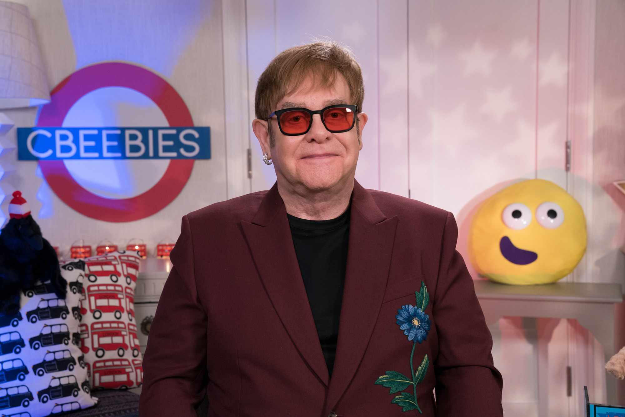 Programme Name: CBeebies Bedtime Stories - TX: n/a - Episode: Elton John (No. n/a) - Picture Shows:  Sir Elton John - (C) BBC  - Photographer: Pete Dadds  BBC, TL