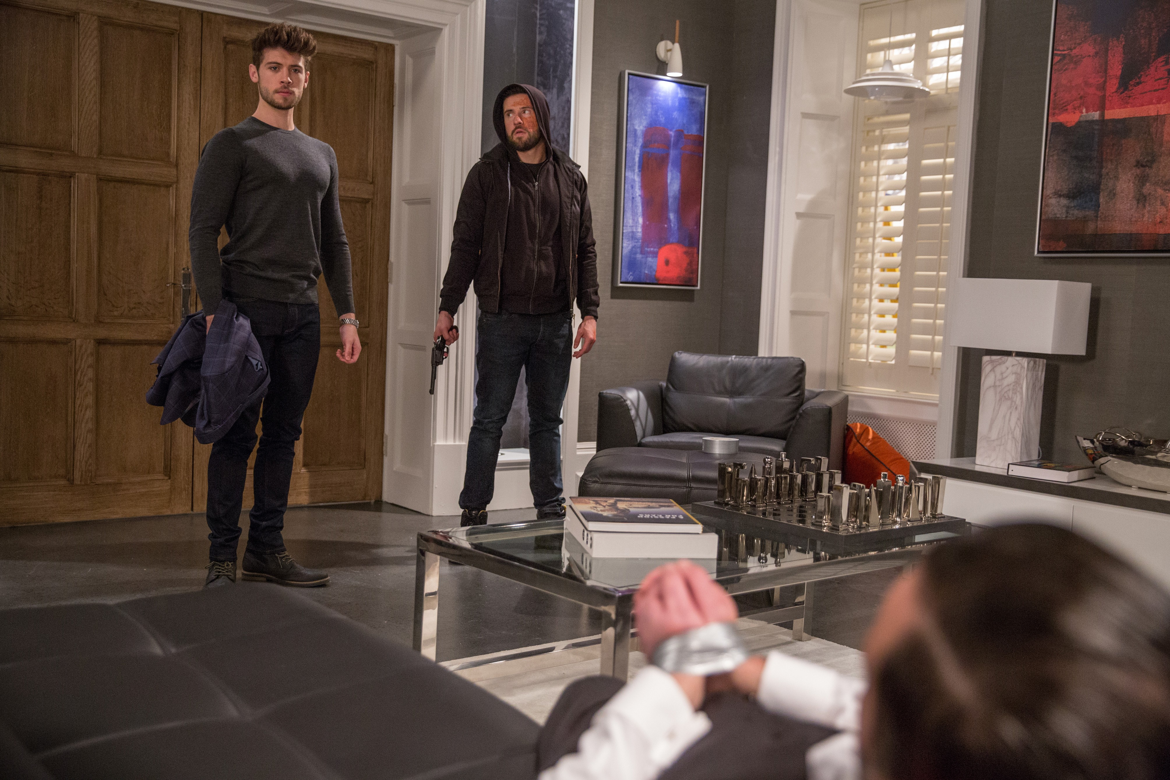 FROM ITV   STRICT EMBARGO  Print media - No Use Before Tuesday 15th May 2018 Online Media -  No Use Before 0700hrs Tuesday 15th May 2018  Emmerdale - Ep 8158  Thursday 24th May 2018 - 1st Ep  Ross Barton [MICHAEL PARR] discovers Simon was paid to keep his mouth shut, and believing Joe Tate [NED PORTEOUS] is involved soon confronts him at gunpoint. Will Joe finally reveal Debbie's terrible secret or will he put his own life on the line to save her? The gun goes off and someone stumbles to the ground but who has been shot?   Picture contact - david.crook@itv.com  Photographer - Amy Brammall  This photograph is (C) ITV Plc and can only be reproduced for editorial purposes directly in connection with the programme or event mentioned above, or ITV plc. Once made available by ITV plc Picture Desk, this photograph can be reproduced once only up until the transmission [TX] date and no reproduction fee will be charged. Any subsequent usage may incur a fee. This photograph must not be manipulated [excluding basic cropping] in a manner which alters the visual appearance of the person photographed deemed detrimental or inappropriate by ITV plc Picture Desk. This photograph must not be syndicated to any other company, publication or website, or permanently archived, without the express written permission of ITV Plc Picture Desk. Full Terms and conditions are available on the website www.itvpictures.com