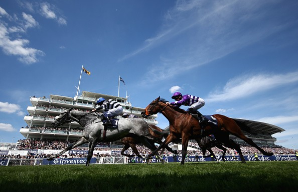 EPSOM, ENGLAND - JUNE 03:  (EDITORS NOTE: POLARIZED FILTER USED) Caspian Prince (L) riding by Tom Eaves wins The Investec Corporate Banking âDashâ Handicap Stakesduring the Investec Derby Day at Epsom Downs Racecourse on June 3, 2017 in Epsom, England.  (Photo by Warren Little/Getty Images)