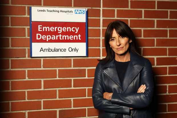 From Optomen TV   A AND E LIVE Tuesday 22nd May Wednesday 23rd May  and Thursday 24th May 2018 on ITV   Pictured:  Davina McCall at the entrance to A and E at Leeds General Infirmary  In this live documentary event, Davina McCall will be experiencing the drama of a major A&E department as it happens. Celebrating 70 years of the NHS, the series will tell the story of emergency medicine across a whole city, from the 999 call to the ambulance right through to treatment in A&E.  Witnessing all the drama from call to cure first hand, Davina will be embedded with the staff of Leeds General Infirmary across the week seeing events unfold through the eyes of the doctors, nurses and paramedics on the frontline. SheÕll experience it, as they do, never knowing who, or what, will come through the doors next. From dealing with everyday traumas to major incidents that require life-saving treatments. This innovative series will show you A&E as you've never seen it before.  Photographer Tony Ward   (c) ITV   For further information please contact Peter Gray 0207 157 3046 peter.gray@itv.com    This photograph is © ITV and can only be reproduced for editorial purposes directly in connection with the  programme NHS AT 70: A AND E LIVE or ITV. Once made available by the ITV Picture Desk, this photograph can be reproduced once only up until the Transmission date and no reproduction fee will be charged. Any subsequent usage may incur a fee. This photograph must not be syndicated to any other publication or website, or permanently archived, without the express written permission of ITV Picture Desk. Full Terms and conditions are available on the website www.itvpictures.com