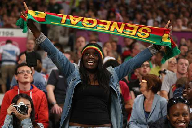 MANCHESTER, ENGLAND - JULY 26:  A Senegal fan celebrates their goal during the Men's Football first round Group A Match of the London 2012 Olympic Games between Great Britain and Senegal, at Old Trafford on July 26, 2012 in Manchester, England.  (Photo by Julian Finney/Getty Images)
