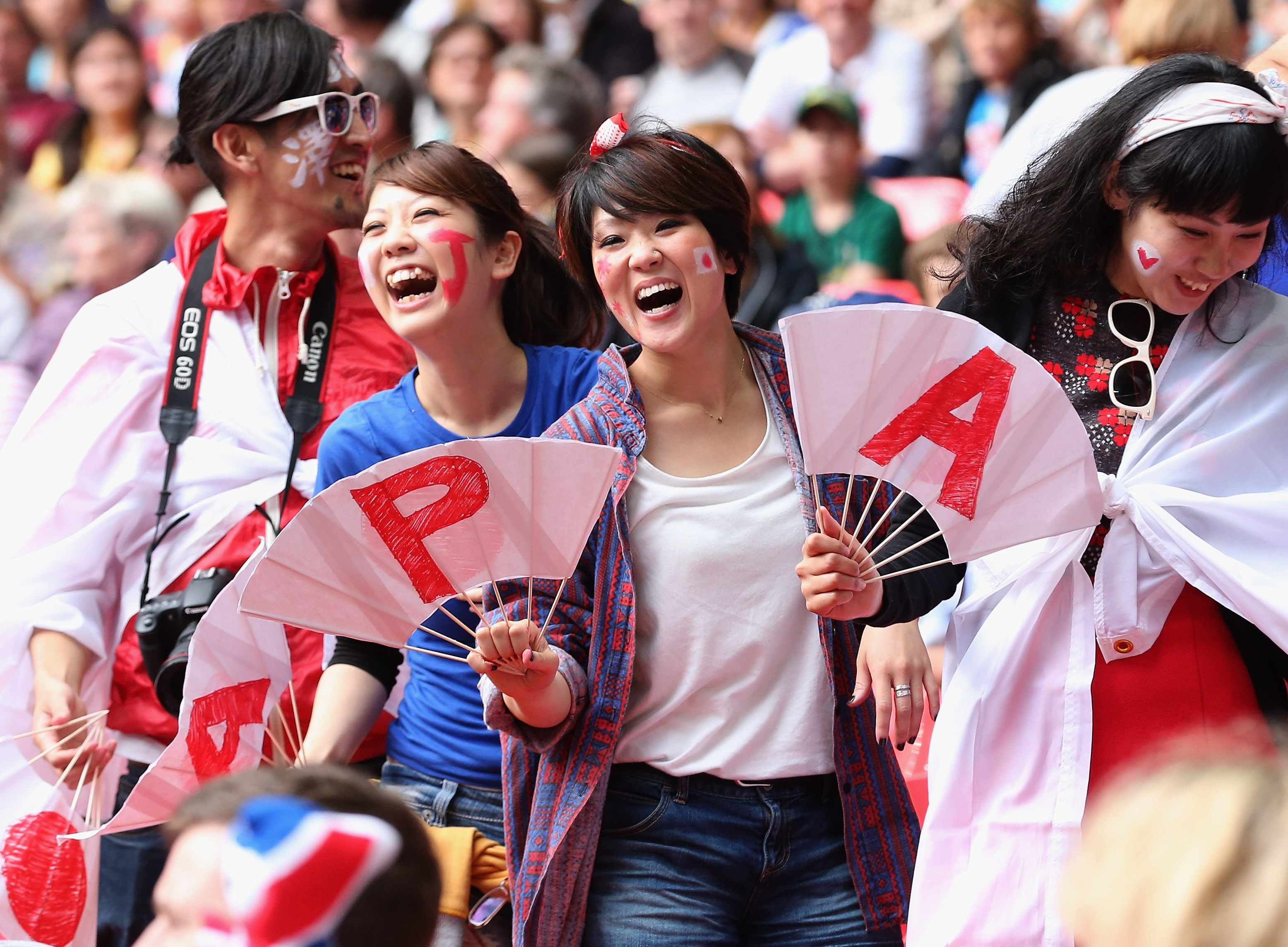 LONDON, ENGLAND - AUGUST 06:  Japan fans show their support during the Women's Football Semi Final match between France and Japan on Day 10 of the London 2012 Olympic Games at Wembley Stadium on August 6, 2012 in London, England.  (Photo by Julian Finney/Getty Images)