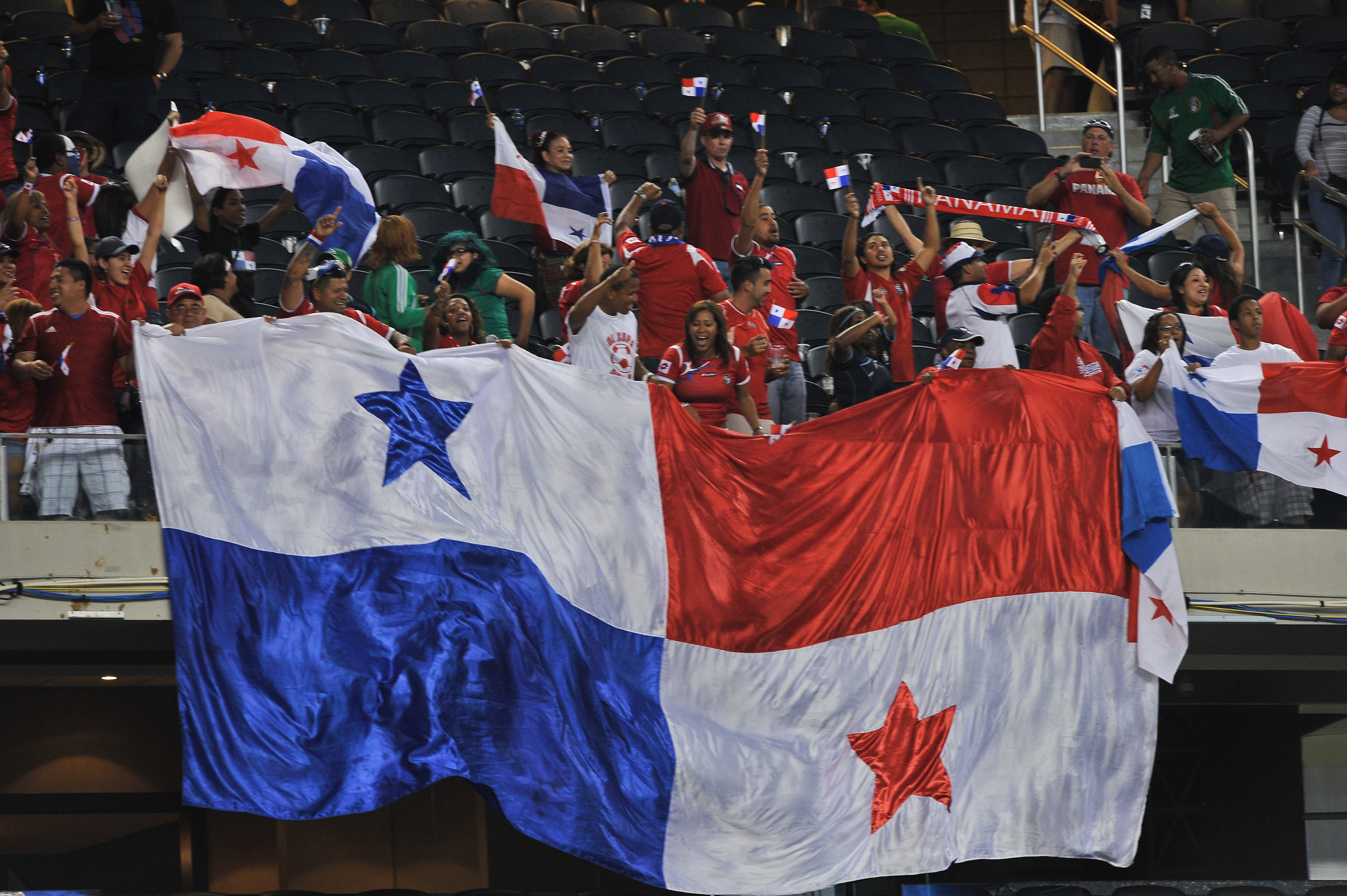 Panama fans celebrate after their team defeated Mexico 2-1 in the Gold Cup semifinals at Cowboys Stadium in Arlington, Texas, on July 24, 2013. Panama will face the US in the final.    AFP PHOTO/Nicholas KAMM        (Photo credit should read NICHOLAS KAMM/AFP/Getty Images)