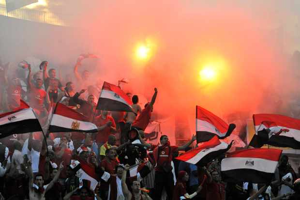 Supporters of Egypt national football team react during the 2014 World Cup qualifying football match between Ghana and Egypt on October 15,2013 at the Babayara Sports Stadium in Kumasi. AFP PHOTO        (Photo credit should read -/AFP/Getty Images)
