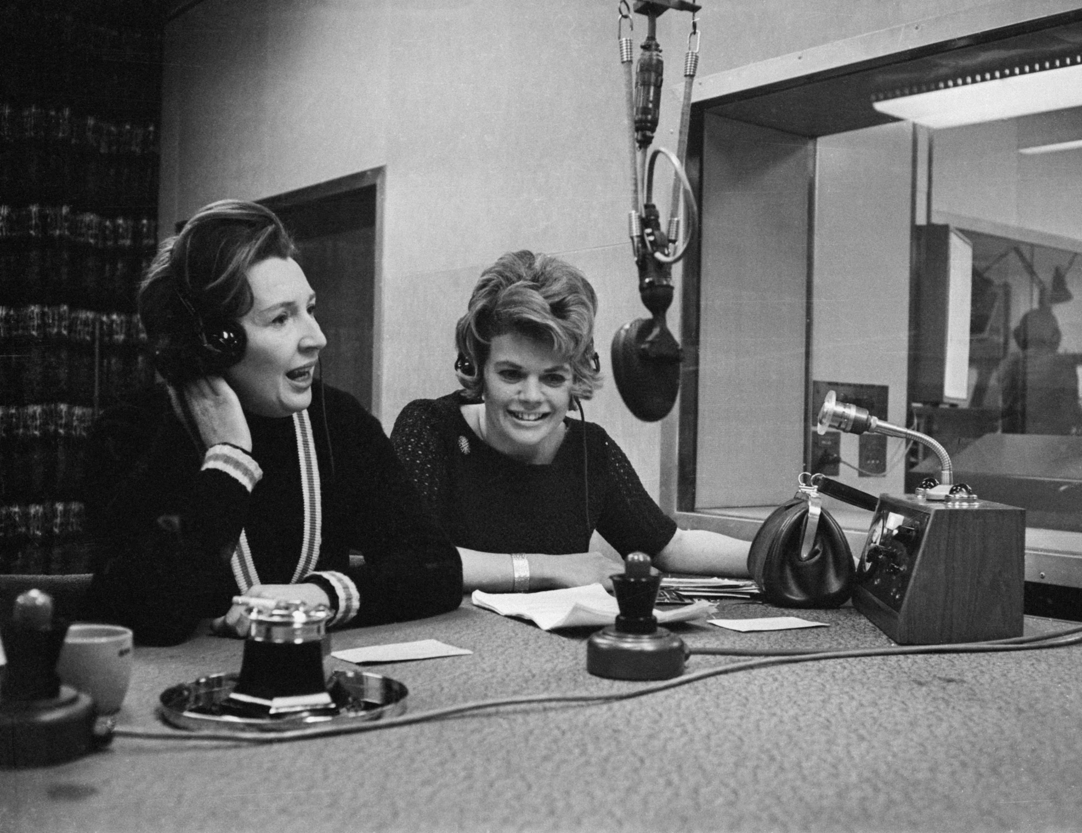 Jean Metcalfe (left) and Judith Chalmers presenting a BBC Radio show (Getty)