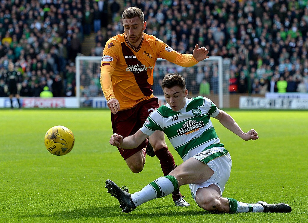 MOTHERWELL, SCOTLAND - APRIL 9 : Kieran Tierney of Celtic is tackled by Louis Moult of Motherwell during the Ladbrokes Scottish Premiership match between Celtic FC and Motherwell FC at Fir Park on April 9, 2016 in Glasgow, Scotland. (Photo by Mark Runnacles/Getty Images)