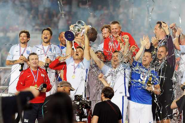 MANCHESTER, ENGLAND - JUNE 05:  Team England celebrates after winning Soccer Aid at Old Trafford on June 5, 2016 in Manchester, England.  (Photo by Dave J Hogan/Dave J Hogan/Getty Images)