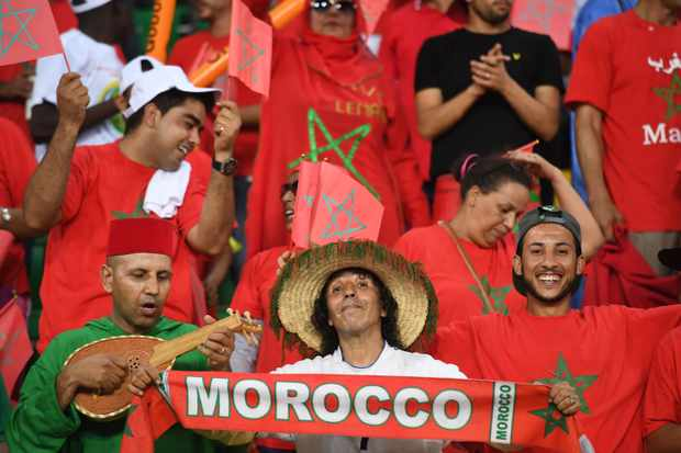 Morocco supporters cheer for their team ahead of the 2017 Africa Cup of Nations quarter-final football match between Egypt and Morocco in Port-Gentil on January 29, 2017. / AFP / Justin TALLIS        (Photo credit should read JUSTIN TALLIS/AFP/Getty Images)