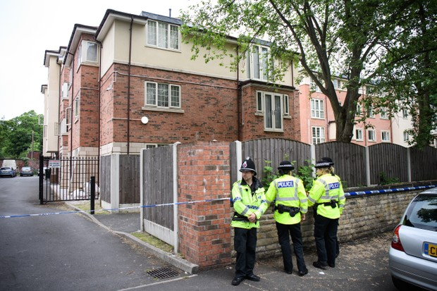 Police officers guard the location of a building where it is believed a raid took place in connection with terrorist Salman Abedi on 24th May 2017 in Manchester (Getty, EH)