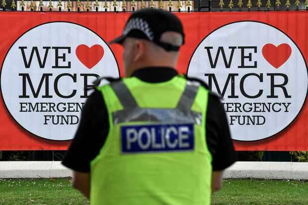Police officers patrol around Old Trafford Cricket Ground ahead of the One Love Manchester tribute concert