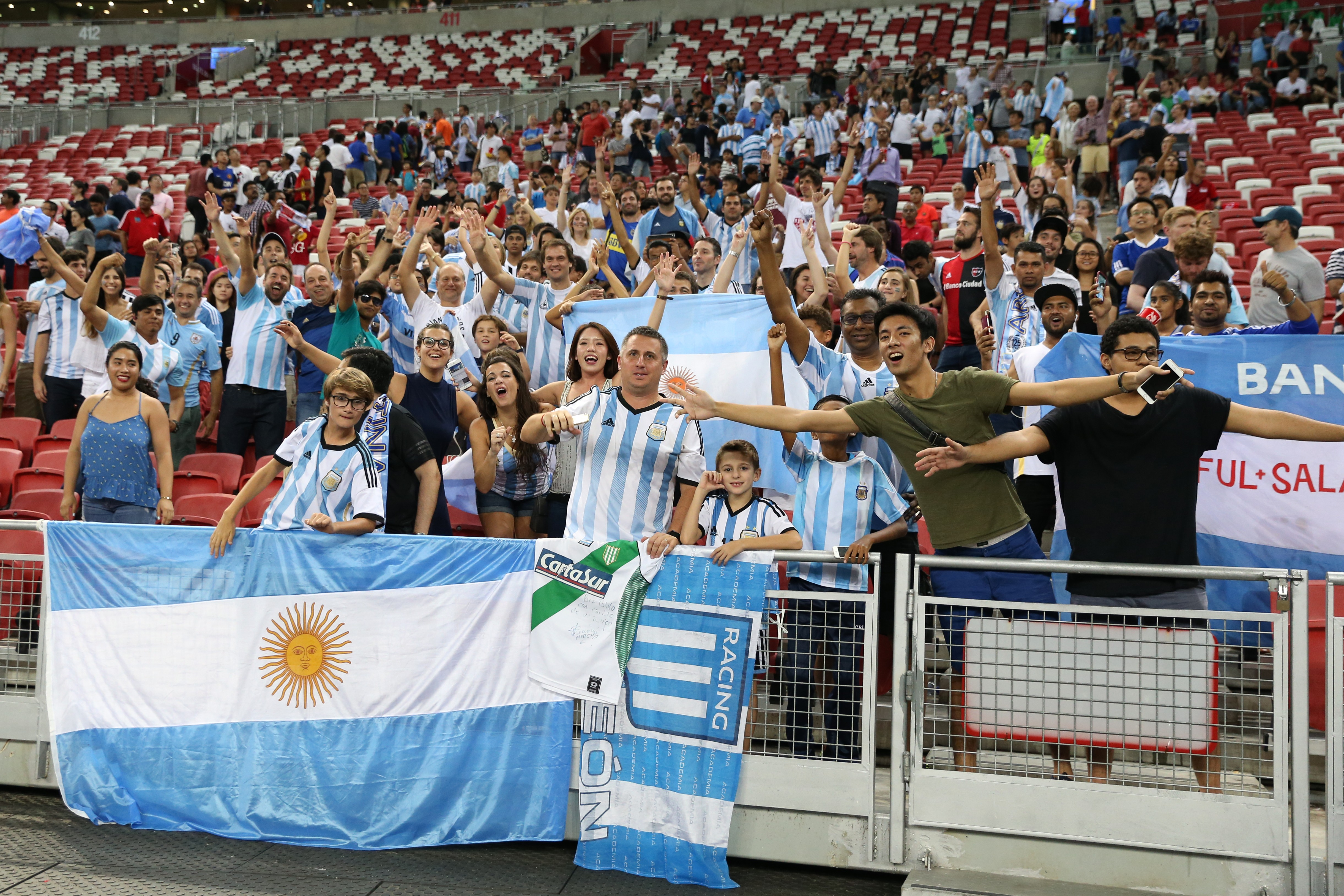SINGAPORE, SINGAPORE - JUNE 13: Argentina fans celebrate after the international friendly match between Argentina and Singapore at National Stadium on June 13, 2017 in Singapore. (Photo by Lionel Ng/Getty Images)