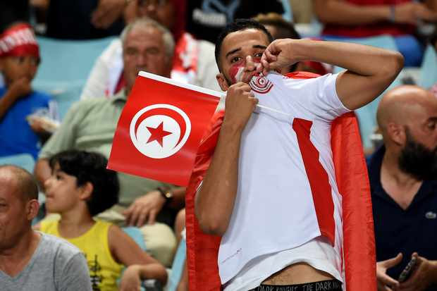 Tunisian fans react during the World Cup 2018 qualifying football match between Tunisia and Congo on September 1, 2017 at the Rades Olympic Stadium in Tunis.  / AFP PHOTO / FETHI BELAID        (Photo credit should read FETHI BELAID/AFP/Getty Images)