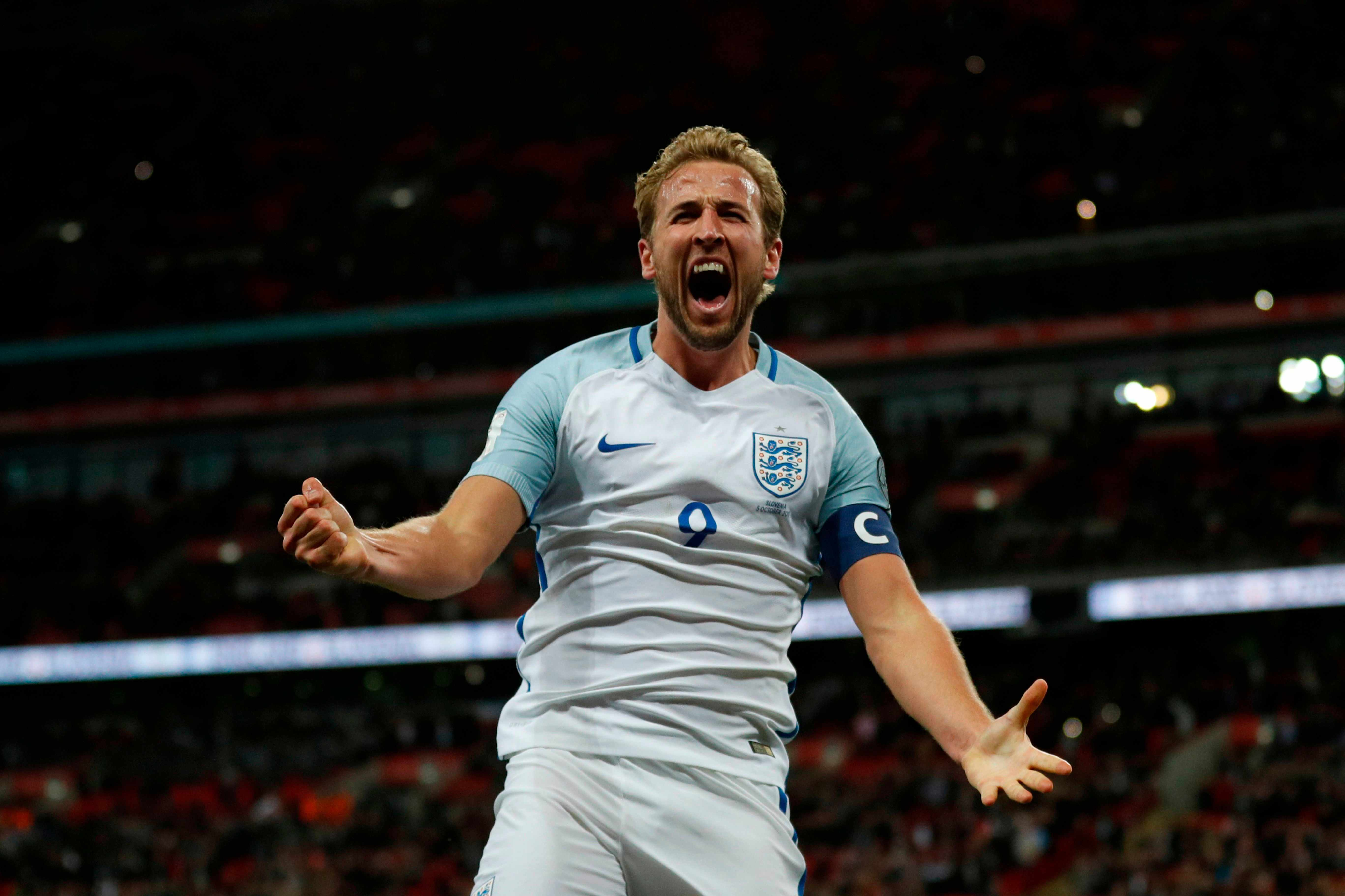 England's striker Harry Kane celebrates scoring the opening goal during the FIFA World Cup 2018 qualification football match between England and Slovenia at Wembley Stadium in London on October 5, 2017.  / AFP PHOTO / Adrian DENNIS / NOT FOR MARKETING OR ADVERTISING USE / RESTRICTED TO EDITORIAL USE        (Photo credit should read ADRIAN DENNIS/AFP/Getty Images)  Getty, TL