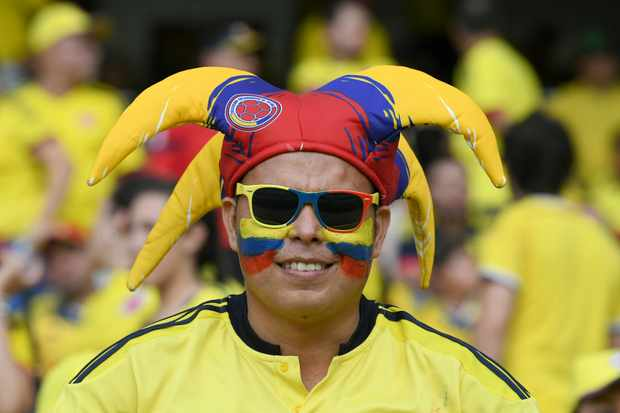 A supporter of Colombia waits for the start of the 2018 World Cup football qualifier match against Paraguay in Barranquilla, Colombia, on October 5, 2017. / AFP PHOTO / Luis ACOSTA        (Photo credit should read LUIS ACOSTA/AFP/Getty Images)