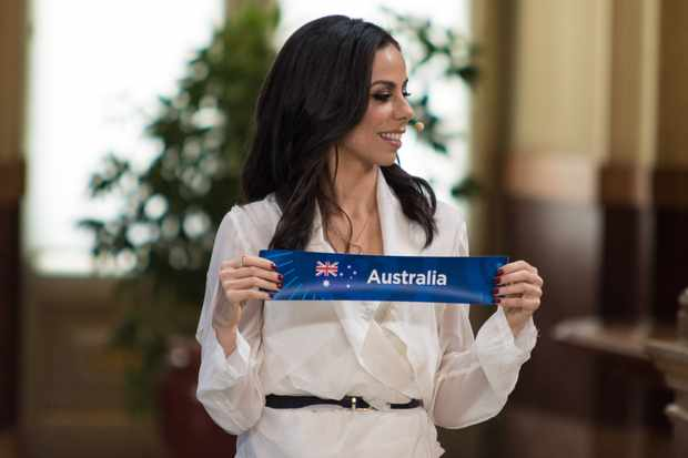 Filomena Cautela who will be part of the presenting team for Eurovision 2018 holds up the sign for Australia during the Eurovision semi-final allocation draw on January 29, 2018 in Lisbon, Portugal.  (Pedro Gomes/Getty Images, SD)