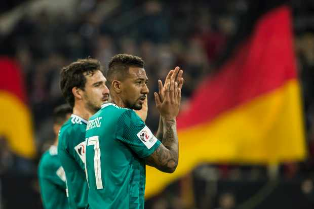 Germany's defender Jerome Boateng (R) and Germany's defender Mats Hummels acknowledge fans after the international friendly football match of Germany vs Spain in Duesseldorf, western Germany, on March 23, 2018, in preparation of the 2018 Fifa World Cup. / AFP PHOTO / ODD ANDERSEN        (Photo credit should read ODD ANDERSEN/AFP/Getty Images)