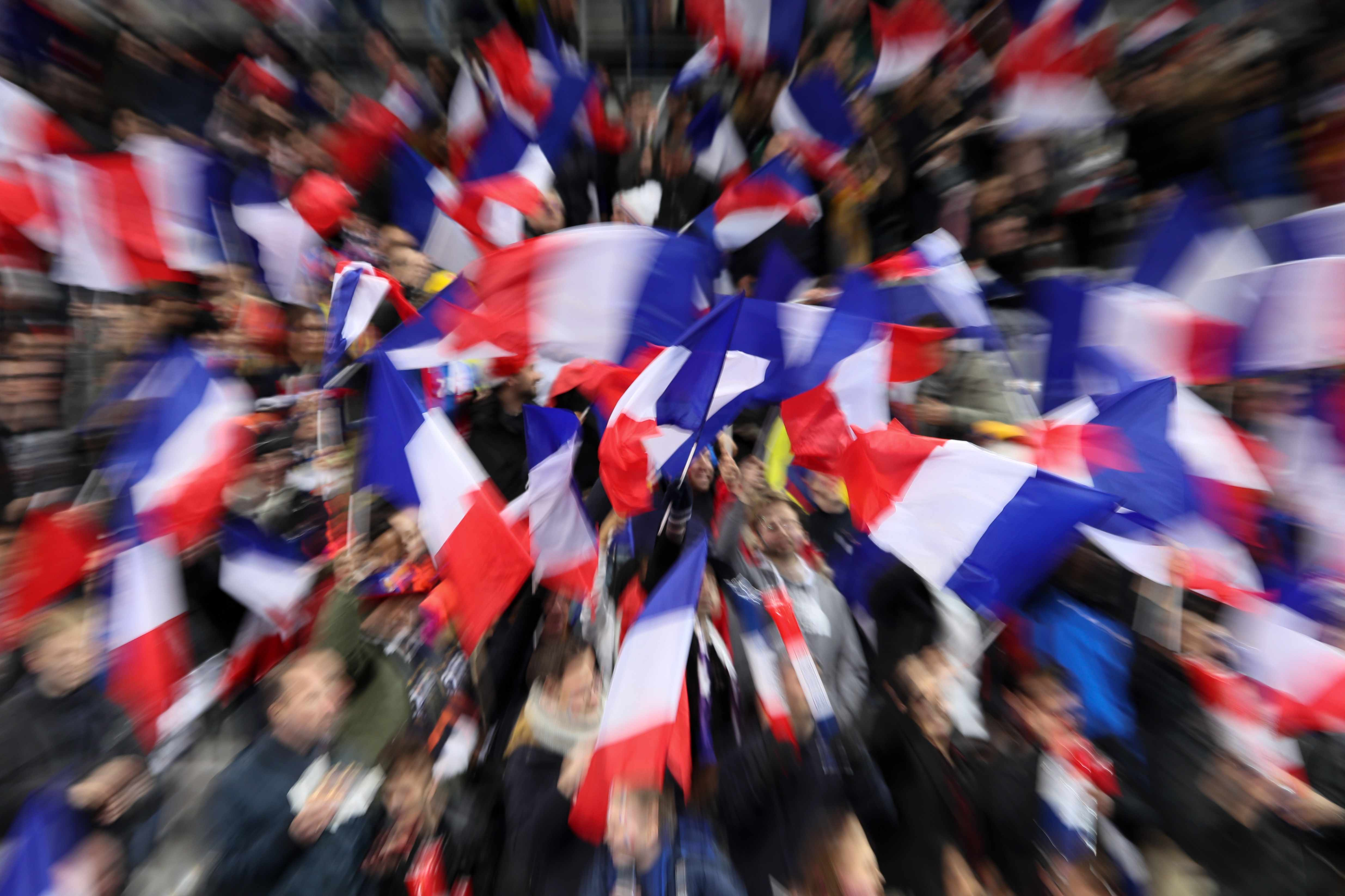 PARIS, FRANCE - MARCH 23: Fans of France wave the national flag during the International Friendly match between France and Colombia at Stade de France on March 23, 2018 in Paris, France. (Photo by Matthew Ashton - AMA/Getty Images)