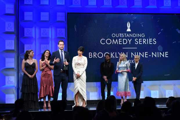 BEVERLY HILLS, CA - APRIL 12:  : (L-R) Chelsea Peretti, Melissa Fumero, Dan Fogelman and Stephanie Beatriz accept the Outstanding Comedy Series award for 'Brooklyn Nine-Nine' from Chloe Grace Moretz and Tom Payne onstage at the 29th Annual GLAAD Media Awards at The Beverly Hilton Hotel on April 12, 2018 in Beverly Hills, California.  (Photo by Vivien Killilea/Getty Images for GLAAD)