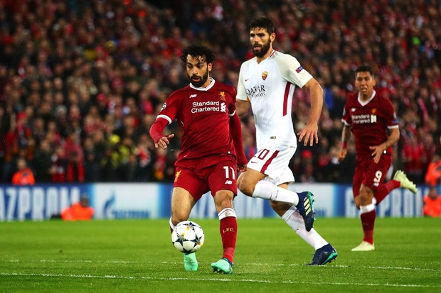 LIVERPOOL, ENGLAND - APRIL 24: Mohamed Salah of Liverpool scores his side's second goal during the UEFA Champions League Semi Final First Leg match between Liverpool and A.S. Roma at Anfield on April 24, 2018 in Liverpool, United Kingdom. (Photo by Chris Brunskill Ltd/Getty Images)