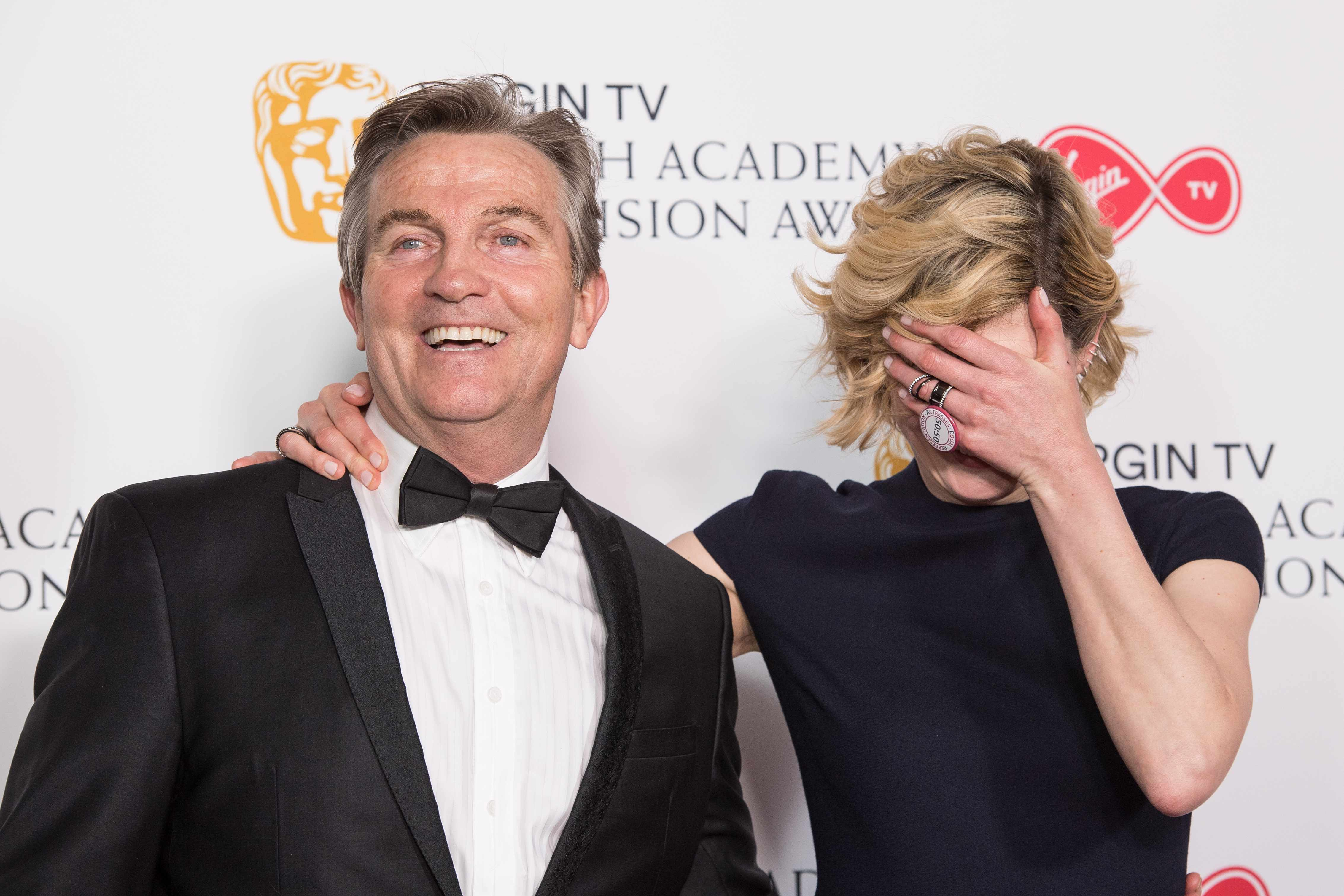 LONDON, ENGLAND - MAY 13:  (L-R)  Bradley Walsh and Jodie Whittaker pose in the press room at the Virgin TV British Academy Television Awards at The Royal Festival Hall on May 13, 2018 in London, England.  (Photo by Jeff Spicer/Getty Images)
