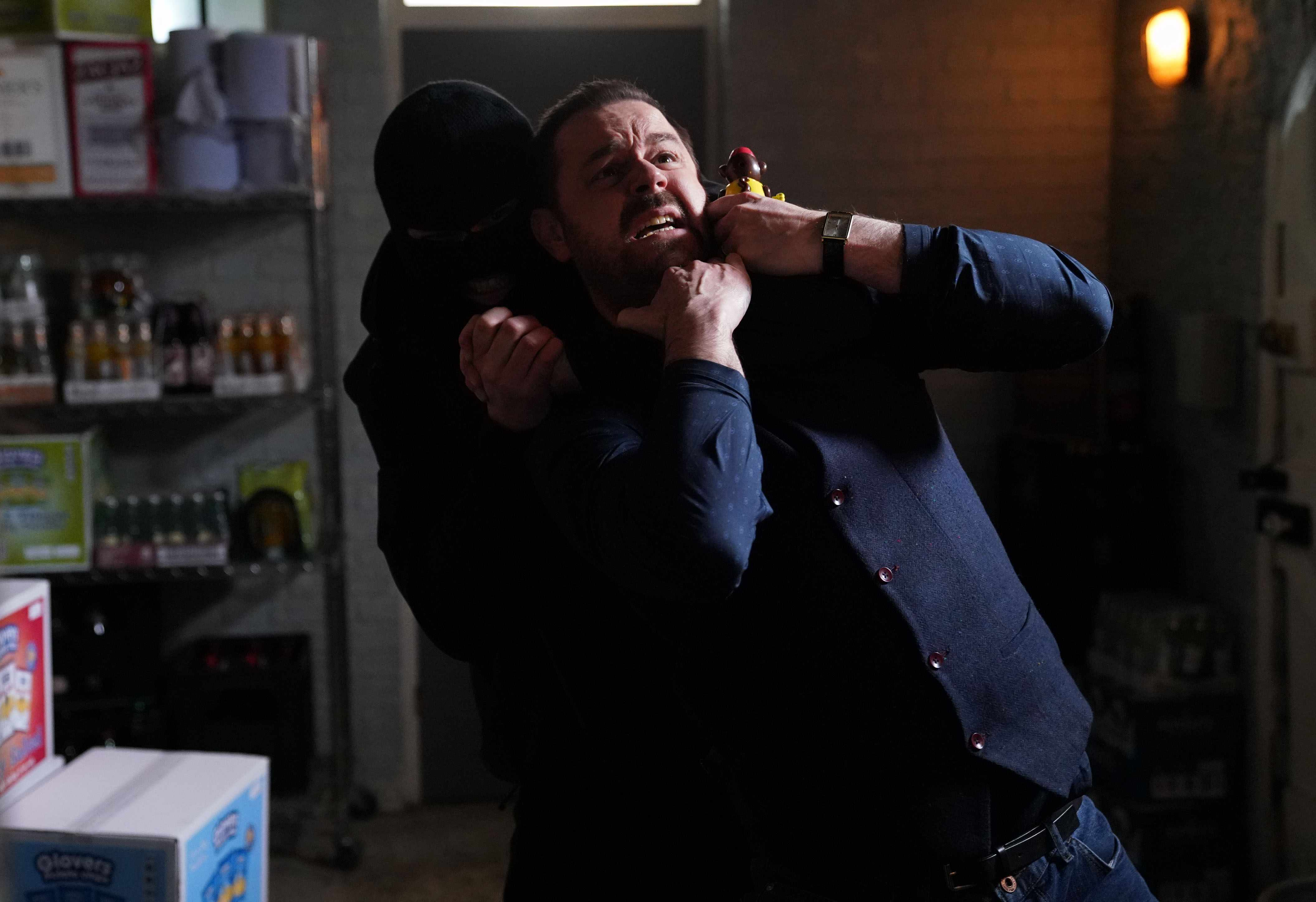 WARNING: Embargoed for publication until 00:00:01 on 09/05/2018 - Programme Name: EastEnders - April-June 2018 - TX: 08/05/2018 - Episode: EastEnders -April-June 2018 - 5703 (No. 5703) - Picture Shows: Mick gets jumped by a man in a balaclava Mick Carter (DANNY DYER) - (C) BBC - Photographer: Kieron McCarron